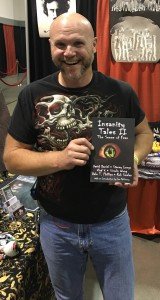 Author Rob Smales holding the new anthology Insanity Tales II from Books & Boos' Press, which contains two of his stories.